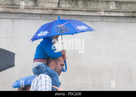 London UK. 9th August 2018. Pedestrians wearing ponchos  shelter from the rain in Whitehall on a wet day as the rains arrive to break the hot spell and summer heatwave Credit: amer ghazzal/Alamy Live News - Stock Photo