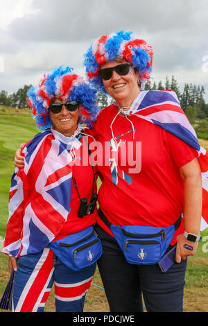 Gleneagles, Scotland, UK. 9th August, 2018. Two friends; ANN MURPHY (left) and HANNAH SYKES (right) travelled from Liverpool to support their favourite golfer; LEE SLATER who partnering Callum SHINKWIN is competing in the four ball match play representing; Great Britain 1. Both women have on red jerseys because they are Liverpool FC supporters. Credit: Findlay/Alamy Live News - Stock Photo