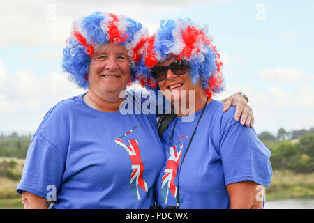 Gleneagles, Scotland, UK. 9th August, 2018. Two friends Janet O'Connor (left) and Sue Cooke (right) travelled from Liverpool to watch and support their favourite golfer Lee Slatery who was playing with Callum Shnkwin in Great Britain 1 at the European Championships 4 ball match play. Both women are wearing blue jerseys because they are Everton supporters Credit: Findlay/Alamy Live News - Stock Photo