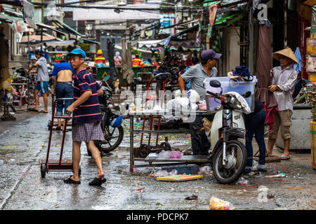 Ho Chi Minh City, Asia - May 12, 2018: Local market being disassembled in central Saigon - Stock Photo