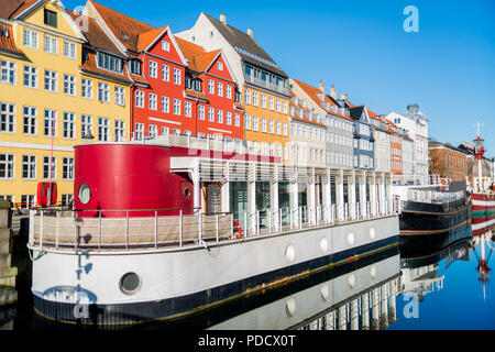 COPENHAGEN, DENMARK - 06 MAY, 2018: Nyhavn pier with buildings, ships, yachts and other boats in the Old Town of Copenhagen, Denmark - Stock Photo