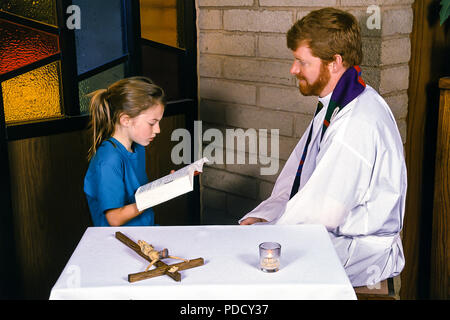 young boy reading Bible to Priest during reconciliation.  © Myrleen Pearson  ....Ferguson Cate - Stock Photo