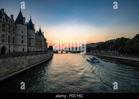 Sunset on the River Seine and the Conciergerie in Paris, France - Stock Photo