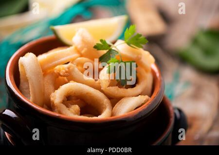 Feesh deep fried calamari squid on a plate - Stock Photo