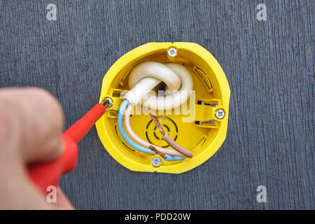 Installation of outlet box for wall electric socket in household electricity power supply network. - Stock Photo