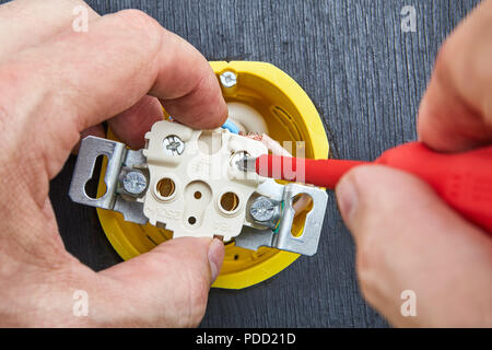 Close-up, installation of household power outlet in home electrical network. - Stock Photo