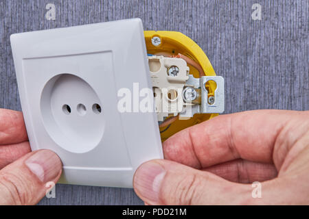 Installing household power outlet in home electrical network, close-up. - Stock Photo
