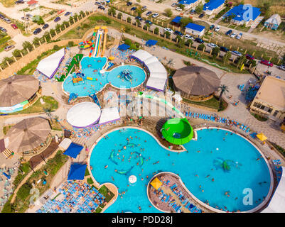 Aerial drone view looking straight down from above colorful summer time fun at water park - Stock Photo