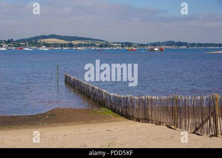 Exe Estuary at High Tide on a Summers Day from Dawlish Warren. Soft Engineering Beach Management Fence. Devon, UK. - Stock Photo