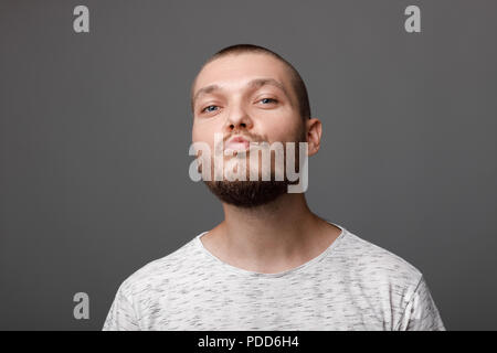 the portrait of the young bearded man - Stock Photo