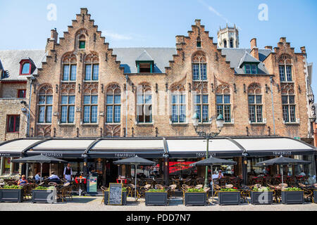Restaurant and cafe in an Burg, in a traditional styled building, Bruges, Belgium - Stock Photo