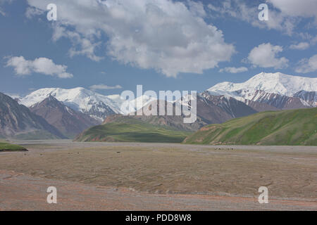 The High Pamirs rise over the start of the Pamir Highway, Kyrgyzstan - Stock Photo