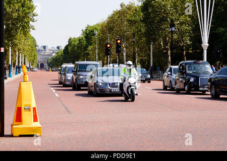 Prime Minister Theresa May convoy with police escort driving down the Mall, City of Westminster, London, England.7th August 2018 - Stock Photo
