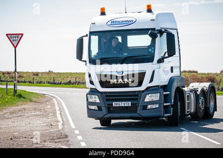 Wincanton MAN truck without trailer turns onto a B road in Derbyshire - Stock Photo