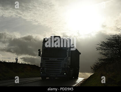 Scania bulk tipper on country road in Winter twilight