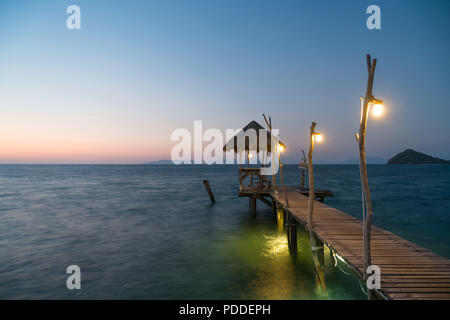 Wooden pier between sunset in Phuket, Thailand. Summer, Travel, Vacation and Holiday concept. - Stock Photo