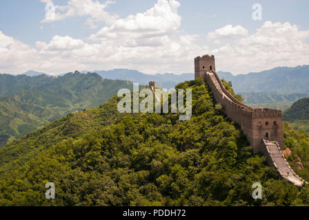 The Great Wall of China at Jinshanling, a popular hiking route and one of the best preserved parts of the Great Wall with many original features. - Stock Photo
