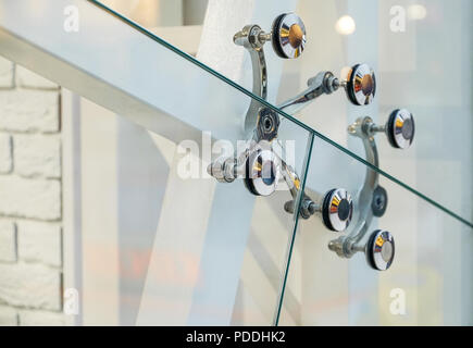 Spider fittings for frameless glass facades and walls. Metal fasteners. - Stock Photo
