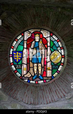 Stained glass window depicting King Edward at Shaftesbury Abbey in Shaftesbury Dorset uk - Stock Photo