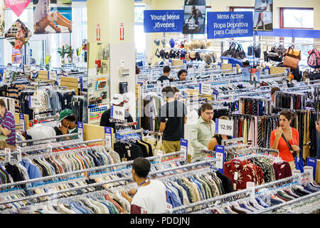 Miami Florida Shops at Midtown Marshall's Department Store Hispanic man woman clothing racks customer retail shop sell buy merch - Stock Photo