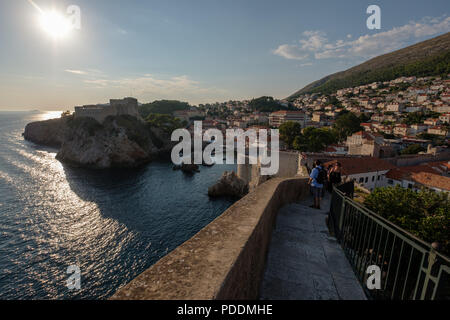 Ancient city walls surrounding old town Dubrovnik, Croatia, Europe - Stock Photo