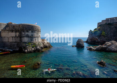 Aerial view of leisure kayaks on the Adriatic Sea, by the city walls of Dubrovnik, Croatia, Europe - Stock Photo