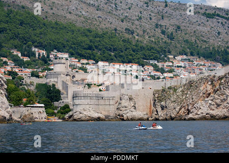 Walls of Dubrovnik old town viewed from the Adriatic sea, Croatia, Europe - Stock Photo