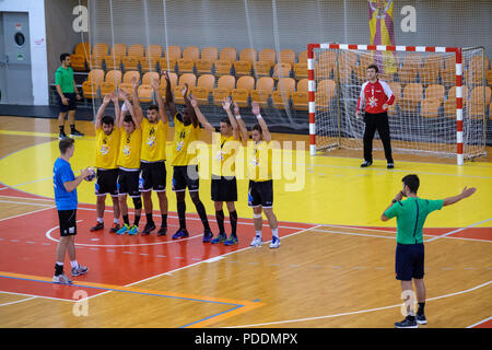 College Handball game between the University of Bochum (Germany) and the Aix-Marseille University (France) during the 2018 European Universities Games - Stock Photo