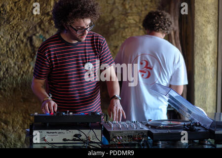 DJ playing music at a party - Stock Photo