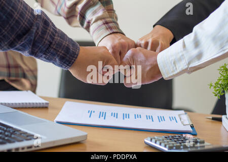 Close-up of business partners making pile of hands at meeting,Team work - Stock Photo