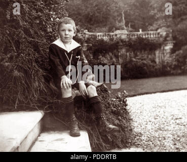 Childhood portrait of C.S. Lewis (Nov. 29, 1898-Nov. 22, 1963), British novelist, academic, medievalist, literary critic, lay theologian, broadcaster, and Christian apologist. Lewis, who held academic positions at both Oxford University and Cambridge University, had as a child been a pupil at Campbell College in Belfast, Ireland (the city where he was born) from September to November 1910. The lampost on the school grounds is believed to have formed part of his inspiration for 'The Lion, the Witch and the Wardrobe' in his popular Chronicles of Narnia series. - Stock Photo