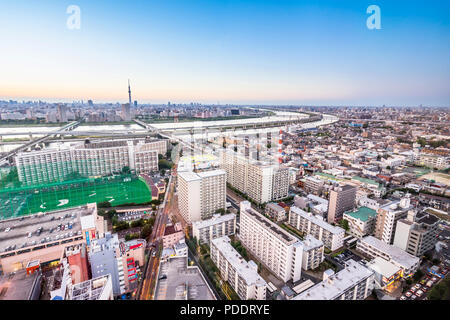 Business and culture concept - panoramic modern city skyline bird eye aerial view with tokyo skytree under dramatic sunset glow and beautiful cloudy s - Stock Photo