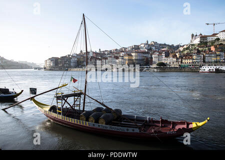 Port Wine boat or rabelo, that used to be used to transport port wine on the river Douro in Porto, Portugal - Stock Photo