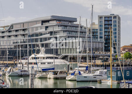 View across the Ocean Village marina to the Southampton Harbour Hotel and Spa, a new five star hotel in Southampton, Hampshire, England, UK - Stock Photo