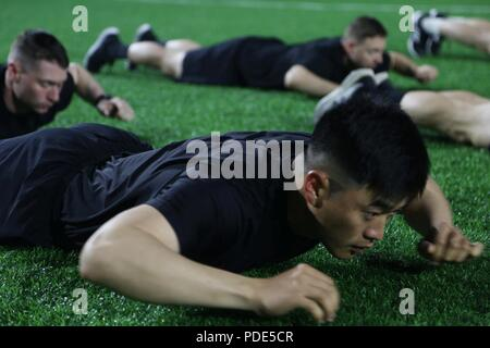 U.S. Army 1st Lt. Austin Kong, native to Dallas, Texas assigned to 339th Quartmaster Company, Camp Humphreys, conducts warm up drills before the Army Physical Fitness Test during the Eighth Army 2018 Best Warrior Competition, held at Camp Casey, Republic of Korea, May 14, 2018.  The Eighth Army Best warrior Competition is being held to recognize and select the most qualified junior enlisted and non-commissioned officer to represent Eighth Army at the U.S. Army Pacific Best Warrior Competition at Schofield Barracks, HI. The competition will also recognize the top performing officer, warrant off - Stock Photo