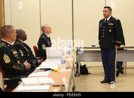 U.S. Army Chief Warrant Officer 2 William Uhila, native to Freemont, California assigned to the 65th Medical Brigade, answers a question at the Warrant Officer Board during the Eighth Army 2018 Best Warrior Competition, held at Camp Casey, Republic of Korea, May 16, 2018.  The Eighth Army Best warrior Competition is being held to recognize and select the most qualified junior enlisted and non-commissioned officer to represent Eighth Army at the U.S. Army Pacific Best Warrior Competition at Schofield Barracks, HI. The competition will also recognize the top performing officer, warrant officer a - Stock Photo