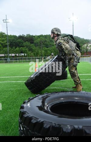 2nd Lt. Brian Trabun, a native of Seattle, WA, assigned to 35th Air Defense Artillery Brigade, flips a tire during the physical fitness challenge during the Eighth Army 2018 Best Warrior Competition, held at Camp Casey, Republic of Korea, May 17. The Eighth Army BWC is being held to recognize and select the most qualified junior enlisted and non-commissioned officer to represent Eighth Army at the U.S. Army Pacific Best Warrior Competition at Schofield Barracks, HI, in June. The competition will also recognize the top performing officer, warrant officer and Korean Augmentation to the U.S. Army - Stock Photo