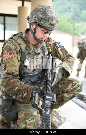 2nd Lt. Brian Trabun, a native of Seattle, WA, assigned to 35th Air Defense Artillery Brigade, assembles an M240 machine gun at the day stakes challenge during the Eighth Army 2018 Best Warrior Competition, held at Camp Casey, Republic of Korea, May 17. The Eighth Army BWC is being held to recognize and select the most qualified junior enlisted and non-commissioned officer to represent Eighth Army at the U.S. Army Pacific Best Warrior Competition at Schofield Barracks, HI, in June. The competition will also recognize the top performing officer, warrant officer and Korean Augmentation to the U. - Stock Photo