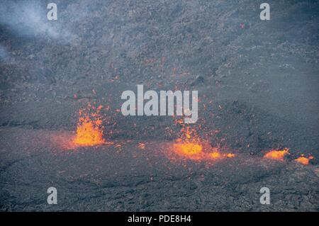 A lava fissure erupts during a volcano outbreak May 17, 2018, at Pahoa, Hawaii. The nearby residential area, Lelani Estates, has been evacuated and is overseen by local authorities with support from members of the Hawaii National Guard. The activated guardsmen are providing around-the-clock presence and guidance to evacuees. - Stock Photo