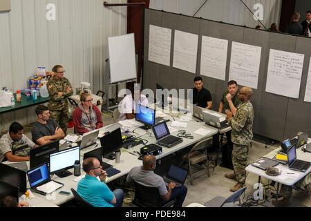 Members of a network defense cell review the team's performance May 18, 2018 during the culminating exercise of Cyber Shield 18, a two week long event at Camp Atterbury, Ind. More than 800 Soldiers, Airmen, federal and state agencies, and civilian partners from 40 states and territories traveled across the country as part of the National Guard's ongoing effort to advance Guard readiness to respond to real-world cyber incidents. (Ohio National Guard - Stock Photo