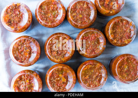 Homemade Preserved Tomato Paste Sauce in Glass Jar. Organic Food. - Stock Photo