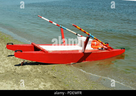 Rescue boat on the beach - Stock Photo