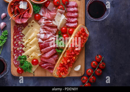 Board of cured meat, cheese and bread with wine, copyspace - Stock Photo