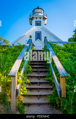 Old Mission Point Lighthouse viewed from the base of the wooden steps to the beach near Traverse City, MI, USA. - Stock Photo