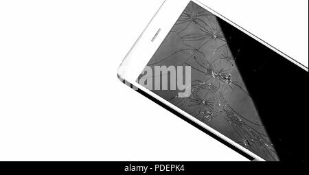 Modern touch screen smartphone with broken screen - Stock Photo