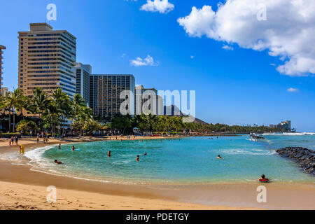 Day time view of Waikiki Beach and Diamond Head in Honolulu in Hawaii, USA - Stock Photo