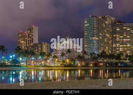 Night view of Waikiki Beach and Diamond Head in Honolulu at night in Hawaii, USA - Stock Photo
