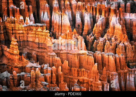 Evening civil twilight glow on the hoodoos of the Silent City from Inspiration Point in Utah's Bryce Canyon National Park. - Stock Photo