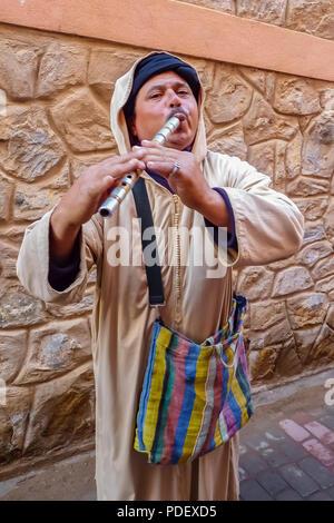 Marrakech, Morocco - December, 08, 2012: Moroccan street flutist in Marrakesh wearing a traditional jellaba - Stock Photo