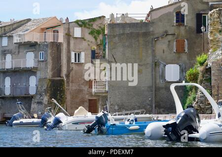 Closeup of old houses with pleasure boats at the seaside - Stock Photo